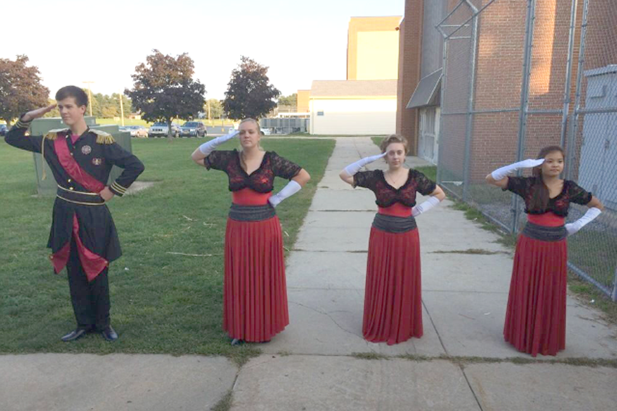 Minutemen marching band Drum majors, Leonard Hotskinson, Emily Faust, Megan Toby and Iona Garate are poised to lead the band into the next competition season.