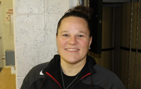 Ms. Taraschi poses in the Auxiliary Gym. She teaches PE on the 9/10 side of the school.