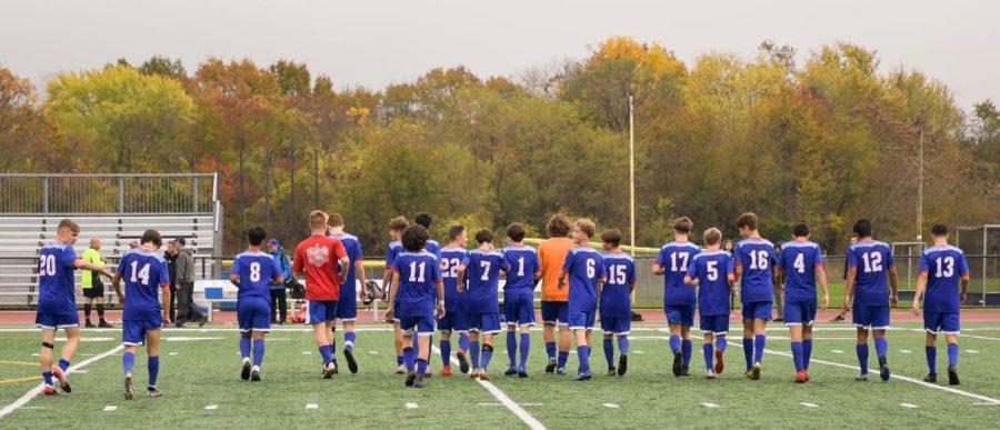 The Washington Township boys soccer team walks off the field with their heads held high.