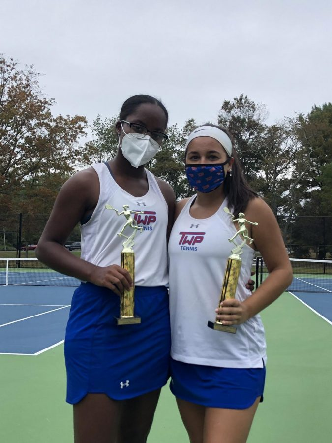 Oldrati and Byrd pose with their trophies after winning the county doubles tournament.