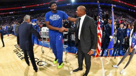 Joel Embiid and Doc Rivers shake hands.